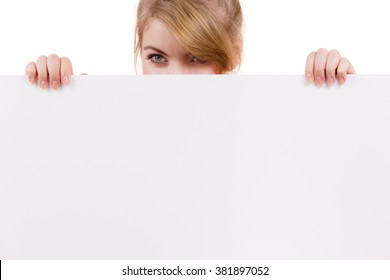 Woman with blank presentation board. Female model showing banner sign billboard copy space for text,  looking down at it. Advertisement concept.