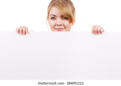 Woman with blank presentation board. Female model showing banner sign billboard copy space for text. Advertisement concept.