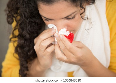 woman bleeding from her nose