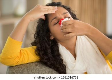 woman bleeding at home