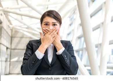 woman blocking her mouth, business compliance concept
