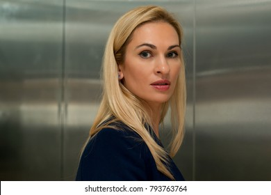 Woman blond in the elevator