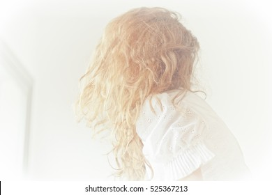 woman blonda hair and vintage wedding dress White light brurred