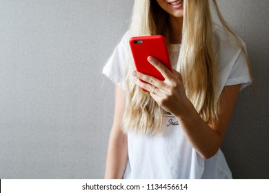 Woman with blonde hair using mobile phone