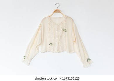Woman blouse is clothes hanger on white background.