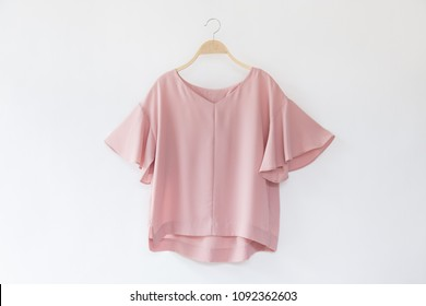 485c7c7c Woman blouse with Pink blouse cotton on white background.