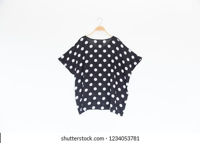 Woman blouse with polka dot blouse cotton on white background.