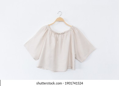 Woman blouse with summer blouse cotton on white background.