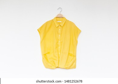 Woman blouse with yellow blouse cotton on white background.