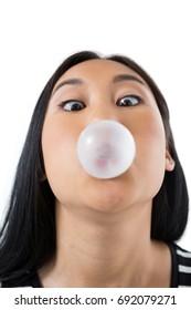 Woman blowing bubble gum against white background