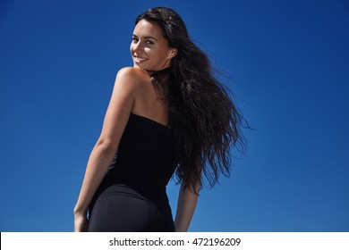 woman with blowing hair