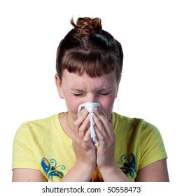 Woman blowing her nose, struggling with allergies