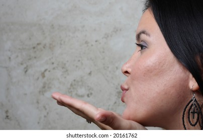 Woman blowing a kiss