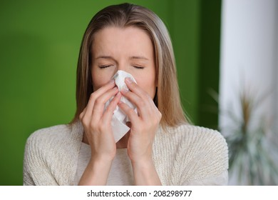 Woman blowing runny nose - Cold flu illness