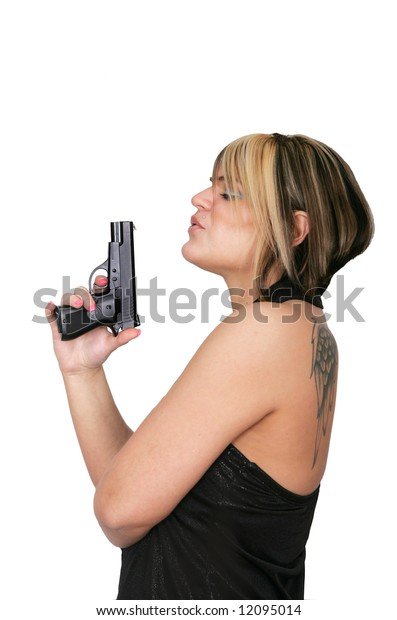 woman blowing the smoke off the tip of her gun barrel