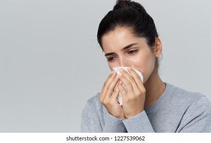 woman blows a napkin