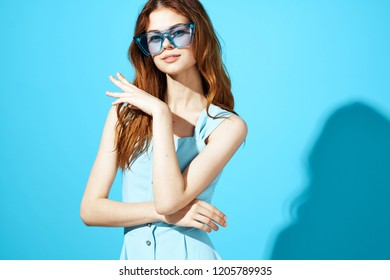 woman in blue dress on blue background