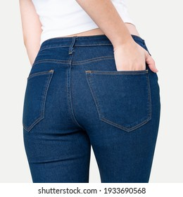 Woman in blue jeans with hand tucked in pocket rear view fashion photoshoot