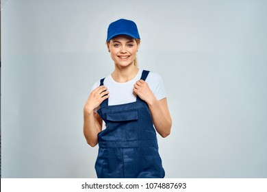 woman in blue overall, courier