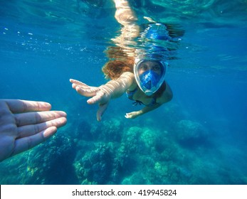 Woman in blue sea, Woman snorkeling in blue sea, Beautiful woman under water before dive to coral reef, woman snorkeling in blue mask, snorkel woman face in mask, summer vacation activity