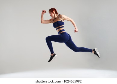 woman in blue sportswear running