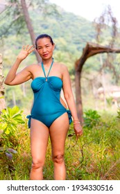 Woman with blue swimsuit stand in nature at beach Koh Chang Thailand.