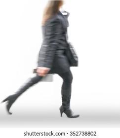 woman in blurry walking