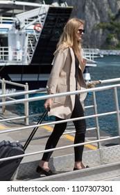 Woman boarding a boat