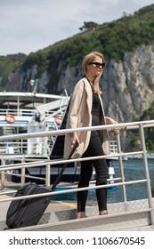 woman boarding a ship
