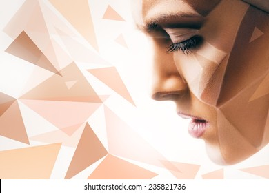 woman with body art on face and geometric pattern in light