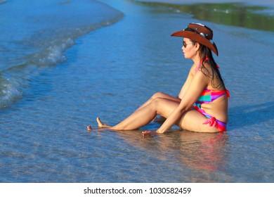 Woman body beautiful bikini and wave morning on beach at Thung Wua Lan Beach, Chumphon Province Thailand