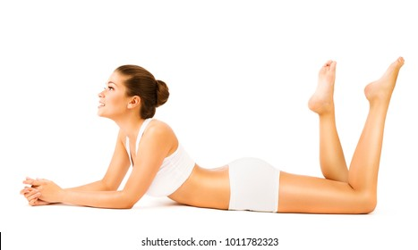 Woman Body Beauty, Young Sexy Girl in White Underwear Lying on Stomach and looking side, Young Model Isolated over white background
