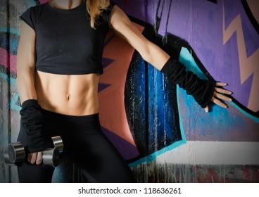 Woman body close up over a graffiti wall