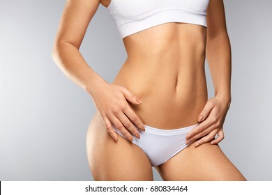 Woman Body. Closeup Of Beautiful Healthy Female With Hairless Smooth Soft Skin In White Bikini Panties. Girl With Perfect Body Shape, Flat Belly In Underwear. Health, Hygiene Concepts. High Resolution
