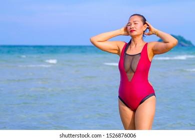 Woman body large sexy bikini crimson on beach at Ban Krut Beach, Prachuap Khirikhan Province Thailand