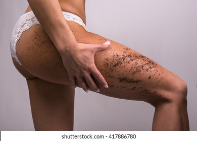 Woman body with scrub coffee grounds. Body care concept. Colorized