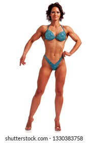 Woman bodybuilder posing on white background, isolated