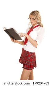 A woman with a book in a school girl outfit.