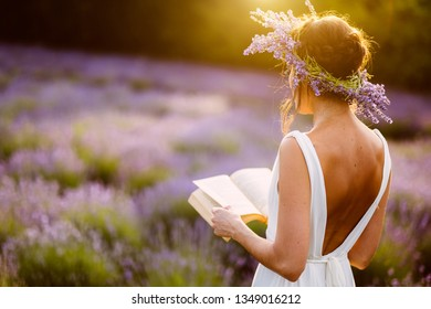 Woman with a book in sunset