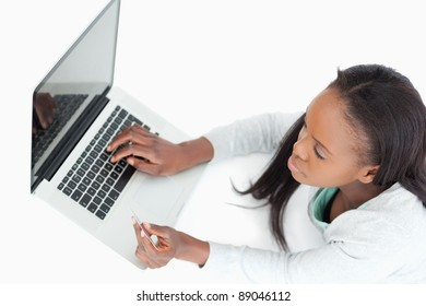 Woman booking a flight online against a white background