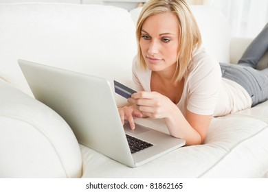 Woman booking holidays on line in her living room