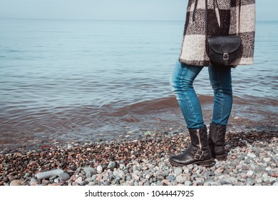 Woman with boots on the beach