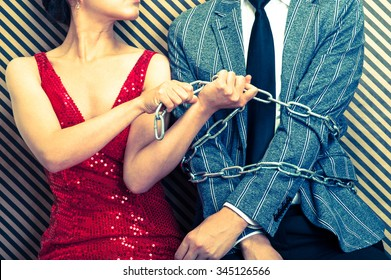 Woman bound men with chain