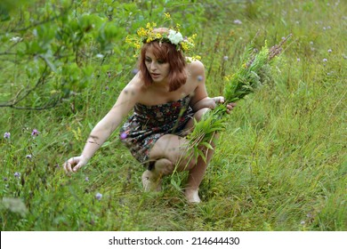 A woman with a bouquet of flowers in hand gathering flowers
