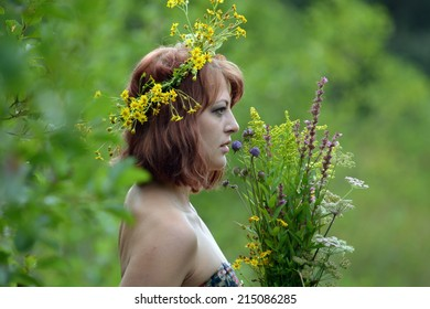 A woman with a bouquet of flowers and a wreath around her head