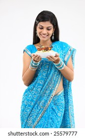 woman with bowl of rice and chicken