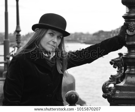 Woman Bowler Hat Stock Photo (Edit Now) 1015870207 - Shutterstock 556d2659f8b3