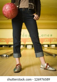 Woman bowling in alley