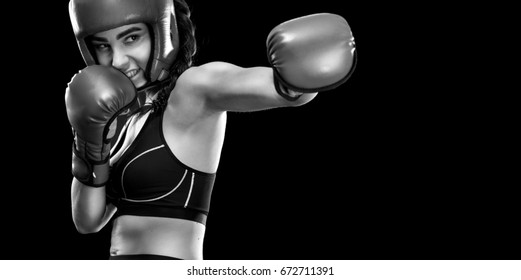 Woman boxer fighting in boxing cage. Isolated on black background. Copy Space. Black and white photo.