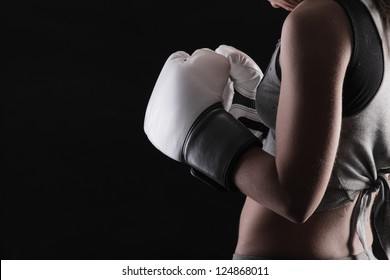 Woman boxer on black background